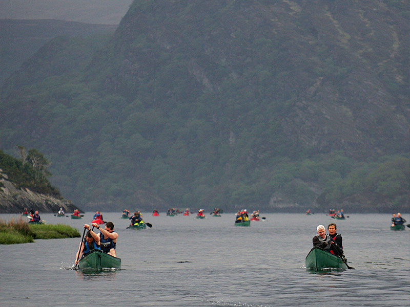 An armada of canoes on the Lakes of Killarney