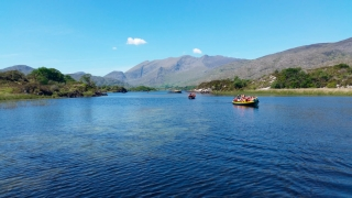 Boating into a remote woodland clearing for a gourmet picnic and hiking start