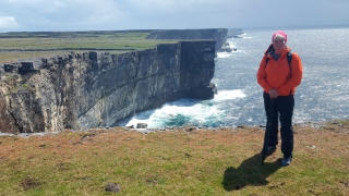 Guide Ann Curran on the majestic cliffs of Inis Mor, the largest of the Aran Islands, County Galway